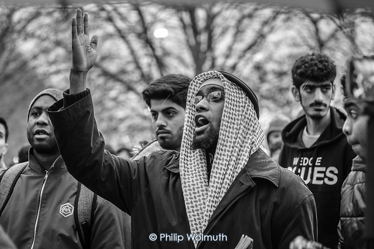 A Muslim  heckles a Christian preacher at Speakers' Corner, Hyde Park, London; 2017.