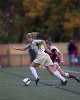 Boston College forward Kristen Mewis (19) starts forward as Florida State defender Kassey Kallman (9) reacts. Florida State University defeated Boston College, 1-0, at Newton Soccer Field, Newton, MA on October 31, 2010.