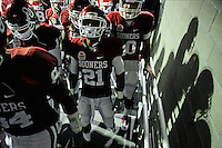 Jan. 1, 2011; Glendale, AZ, USA; Oklahoma Sooners players head through the tunnel prior to entering the field prior to the game against the Connecticut Huskies in the 2011 Fiesta Bowl at University of Phoenix Stadium. The Sooners defeated the Huskies 48-20. Mandatory Credit: Mark J. Rebilas-