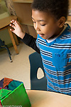 Education Preschool 4 year olds boy happy with magnet tiles construction