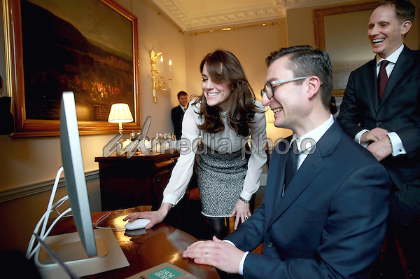 17 February 2016 - London, England - Kate Duchess of Cambridge Catherine launches a story on 'Early Intervention in Mental Health Care' watched by James Martin (Executive Editor Huff Post UK) and Steven Hull (Editor in Chief Huff Post UK) on the Huffington Post landing page in the 'News Room' at Kensington Palace in London. The Duchess of Cambridge is supporting the launch of the Huffington Post UK's initiative 'Young Minds Matter' by guest editing the Huffington Post UK today from Kensington Palace. Photo Credit: Alpha Press/AdMedia
