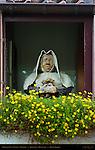 Perplexed Nun in Window of Begijnhof, Beguinage, Minnewater, Bruges, Brugge, Belgium