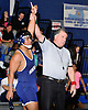Jon Canas of Huntington has his arm raised by referee Sean Brocking after defeating Audwin Philip of North Babylon at 182 pounds in the opening round of the Suffolk County varsity wrestling championship at North Babylon High School on Wednesday, Jan. 27, 2016. Canas rallied from a deficit to force overtime. He then scored a two-point takedown for an 8-6 decision to help 13th seeded Huntington to a 34-33 upset over fourth seeded North Babylon.