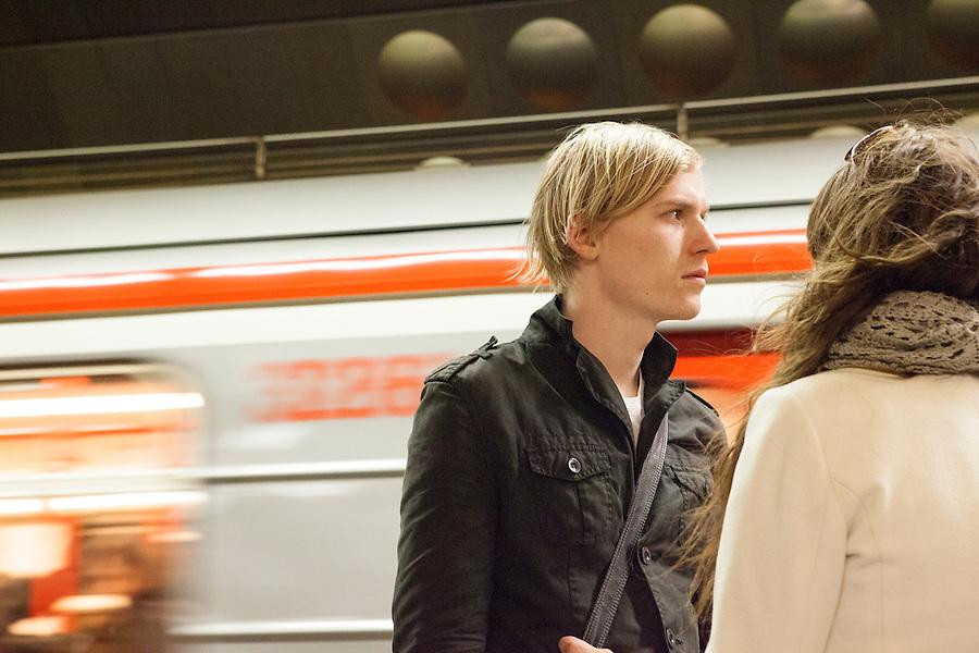 20-something couple standing on the subway platform in the Prague Metro, Prague, Czech Republic, Europe