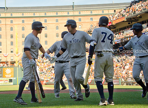 New York Yankees third baseman Chase Headley (12) celebrates with his teammates on the field after scoring his team's seventh and final run during their ninth inning rally against the Baltimore Orioles at Oriole Park at Camden Yards in Baltimore, MD on Sunday, April 9, 2017.  The Yankees won the game 7 - 3. <br /> Credit: Ron Sachs / CNP<br /> (RESTRICTION: NO New York or New Jersey Newspapers or newspapers within a 75 mile radius of New York City)