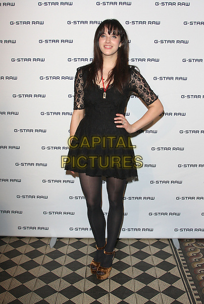 JESSICA BROWN-FINDLAY .Attending the G-Star Raw Party at One Mayfair, London, England, UK,.January 13th 2011..full length hand on hip tights brown platform open toe shoes sandals black dress lace red necklace .CAP/ROS.©Steve Ross/Capital Pictures