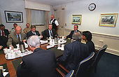 United States President George W. Bush meets with US Secretary of Defense Donald H. Rumsfeld and his staff at the Pentagon in Washington, DC on September 12, 2001.  From left to right is Secretary of the Army Thomas E. White, Deputy Secretary of Defense Paul Wolfowitz, Secretary Rumsfeld, President Bush, and National Security Advisor Condoleeza Rice.  Bush inspected the site of the terrorist attack on the building and thanked the men and women who assisted in containing the fires and rescuing victims. <br /> Credit: DoD via CNP