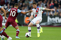 James McCarthy of Crystal Palace and Manuel Lanzini of West Ham United during West Ham United vs Crystal Palace, Premier League Football at The London Stadium on 5th October 2019