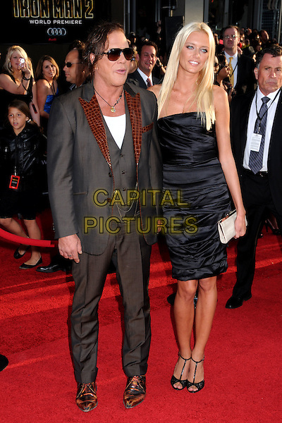 "MICKEY ROURKE & ANASTASSIJA MAKARENKO .""Iron Man 2"" World Premiere held at the El Capitan Theatre, Hollywood, California , USA, .26th April 2010..arrivals full length couple strapless black dress peep toe t-bar shoes sandals clutch bag waistcoat grey gray sunglasses grey gray brown lapel necklace white vest croc suit jacket holding hands .CAP/ADM/BP.©Byron Purvis/AdMedia/Capital Pictures."