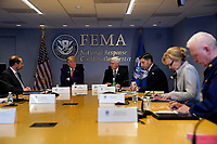 United States President Donald J. Trump attends a teleconference with governors at the Federal Emergency Management Agency headquarters, Thursday, March 19, 2020, in Washington, DC. From left, US Secretary of Health and Human Services (HHS) Alex Azar, President Trump, US Vice President Mike Pence, acting US Secretary of Homeland Security Chad Wolf, Dr. Deborah L. Birx, White House Coronavirus Response Coordinator, and Admiral Brett Giroir, US Assistant Secretary for Health. <br /> Credit: Evan Vucci / Pool via CNP/AdMedia