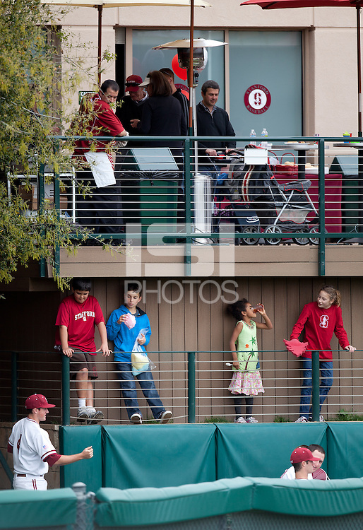 STANFORD, CA - March 27, 2011: Kids hangout by the bullpen during Stanford's game against Long Beach State at Sunken Diamond. Sunday's game was Kids' Day. Stanford won 6-5.