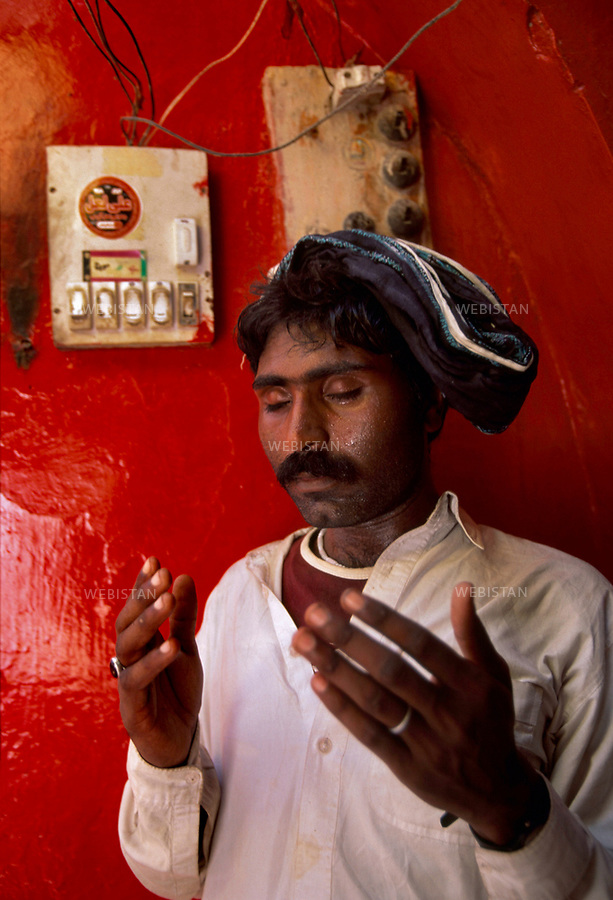 SEHWAN SHARIF, PAKISTAN - SEPTEMBER, 2006:  Portrait of a pilgrim praying during the annual celebration of Urs  of Lal shahbaz Qalandar a 13th century Sufi Master worshiped alike by Hindus and Muslims. Born as Seyed Shah Hussain (Usman) Marandi, he later on titled as Lal (red) Shahbaz ( Falcon) Qalandar (as he belonged to Qalandria order of sufism).
