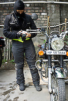 Suzanne Lee filming with the Sony ActionCam POV cameras while on a motorcycle ride Across the Indian Himalayas with Sanjit Das on Royal Enfield motorcycles. Photo by Sanjit Das/Panos Pictures