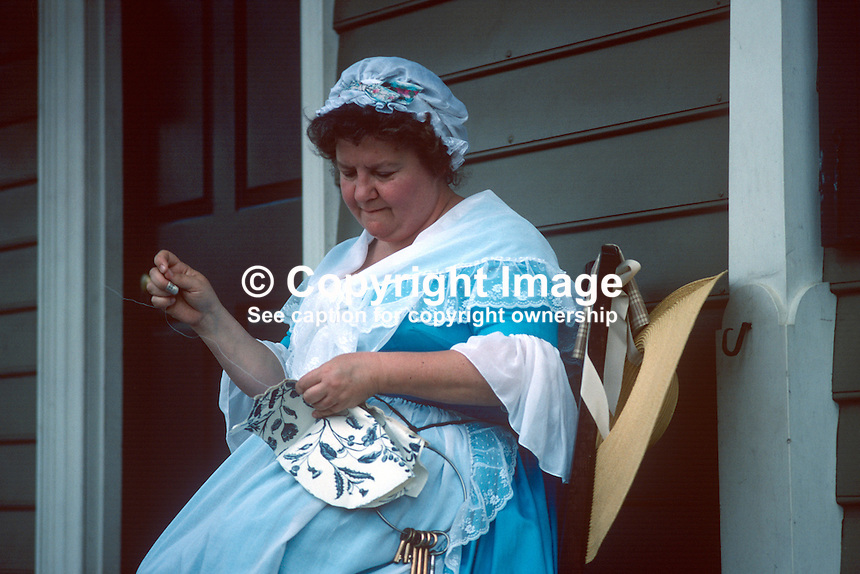 "One of the ""residents"" in period custume in the Colonial Williamsburg Historic Area, the restored capital of 18th century Virginia, embroidering on her veranda. 19880505CW3..Copyright Image from Victor Patterson, 54 Dorchester Park, Belfast, UK, BT9 6RJ..Tel: +44 28 9066 1296.Mob: +44 7802 353836.Voicemail +44 20 8816 7153.Skype: victorpattersonbelfast.Email: victorpatterson@me.com.Email: victorpatterson@ireland.com (back-up)..IMPORTANT: If you wish to use this image or any other of my images please go to www.victorpatterson.com and click on the Terms & Conditions. Then contact me by email or phone with the reference number(s) of the image(s) concerned."