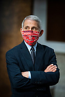 Anthony Fauci, director of the National Institute of Allergy and Infectious Diseases, wears a Washington Nationals protective mask while arriving to a Senate Health, Education, Labor and Pensions Committee hearing in Washington, D.C., U.S., on Tuesday, June 30, 2020. Top federal health officials are expected to discuss efforts to get back to work and school during the coronavirus pandemic. <br /> Credit: Al Drago / Pool via CNP /MediaPunch