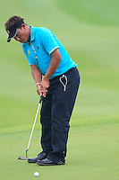 Thongchai Jaidee (THA) putts on the 1st green during Thursday's Round 1 of the 2014 BMW Masters held at Lake Malaren, Shanghai, China 30th October 2014.<br /> Picture: Eoin Clarke www.golffile.ie