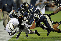 6 November 2010:  FIU defensive end Tourek Williams (97), defensive back Jose Cheeseborough (27) and cornerback Chuck Grace (21) combine to tackle Louisiana-Monroe running back Frank Goodin (5) in the second quarter as the FIU Golden Panthers defeated the University of Louisiana-Monroe Warhawks, 42-35 in double overtime, at FIU Stadium in Miami, Florida.