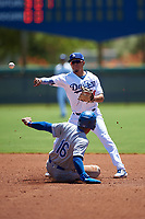 AZL Dodgers Lasorda second baseman Aldo Espinoza (10) throws to first base over Gary Camarillo (16) to complete a double play during an Arizona League game against the AZL Royals on July 4, 2019 at Camelback Ranch in Glendale, Arizona. The AZL Royals defeated the AZL Dodgers Lasorda 4-1. (Zachary Lucy/Four Seam Images)