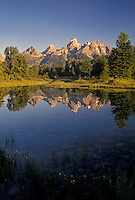 Grand Teton National Park, Snake River, Jackson Hole, WY, Wyoming, Scenic view of the Grand Teton Mountains reflecting in the calm waters of the Snake River at sunrise in Grand Teton Nat'l Park in Wyoming.