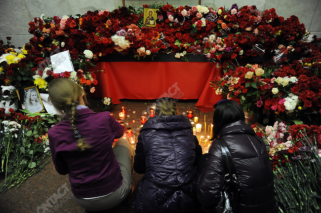 A wall of flowers and candles stood in the centre of the Lubyanka metro station in Moscow where a terrorist attack killed more than two dozen people as commuters came to pay their respects to those who died. Moscow, Russia, March 30, 2010