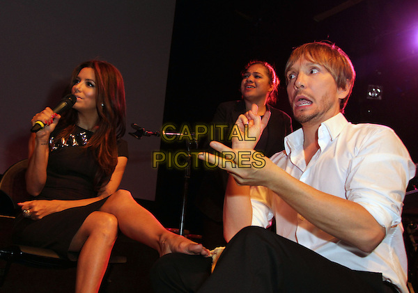 Eva Longoria, Ken Pave.9th Annual GLAD Benefit Extravaganzaa  Held At The House of Blues, West Hollywood, California, USA..June 5th, 2011.full length black dress microphone sitting leg legs up foot massage rub rubbing mouth open hands funny.CAP/ADM/KB.©Kevan Brooks/AdMedia/Capital Pictures.