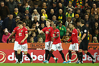 27th Ocotber 2019; Carrow Road, Norwich, Norfolk, England, English Premier League Football, Norwich versus Manchester United; Scott McTominay of Manchester Utd celebrates with team mates as he scores for 0-1 in the 21st minute - Strictly Editorial Use Only. No use with unauthorized audio, video, data, fixture lists, club/league logos or 'live' services. Online in-match use limited to 120 images, no video emulation. No use in betting, games or single club/league/player publications
