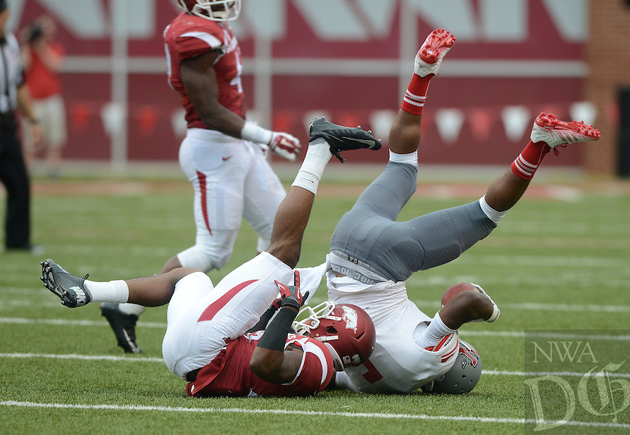 STAFF PHOTO ANTHONY REYES &bull; @NWATONYR<br /> Rohan Gaines, Razorbacks safety, tackles Tobias Lofton Nicholls State running back in the third quarter Saturday, Sept. 6, 2014 at Razorback Stadium in Fayetteville. The Hogs won 73-7.