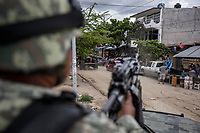 "June 17, 2018: A military convoy surveils ""Zapata"" vicinity, a violence-plagued neighbourhood in Acapulco, Guerrero. A juncture of security forces, among them military, marines, federal police and local police joined under one-command to fight crime violence in the once-glamorous resort destination."
