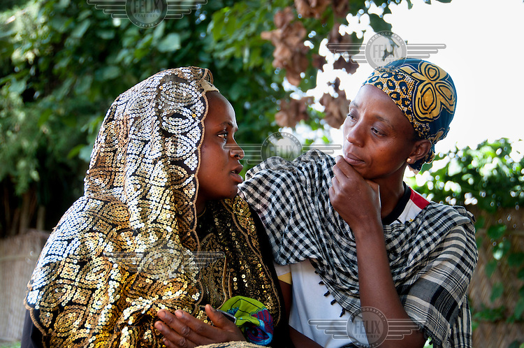 Chanteh Ajaratu (right) a widow who has been fighting for 16 years for her right to land.