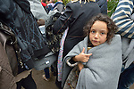 Wrapped in a blanket against the cold, a refugee girl approaches the border into Croatia near the Serbian village of Berkasovo. Hundreds of thousands of refugees and migrants from Syria, Iraq and other countries--including many children--have flowed through Serbia in 2015, on their way to western Europe.