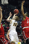 Iowa's Mike Gesell (10) goes to the basket while being guarded by Davidson's Jack Gibbs (12)  and Jordan Barham (5) during 2015 NCAA Division I Men's Basketball Championship March 20, 2015 at the Key Arena in Seattle, Washington.  Iowa beat Davidson 83-52.   ©2015. Jim Bryant Photo. ALL RIGHTS RESERVED.