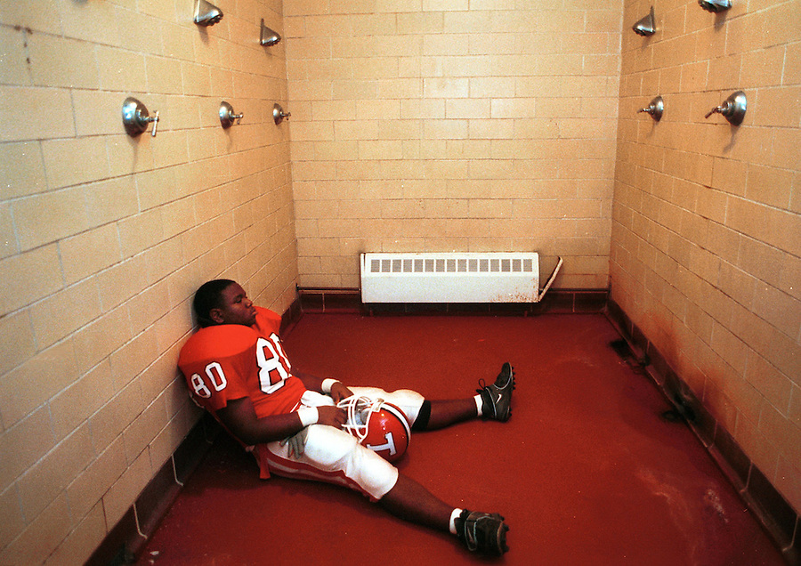 Thomasville High School offensive lineman Matt Mathis clears his mind in the team showers before the start of the homecoming game.