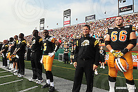 September 7, 2009; Hamilton, ON, CAN; Hamilton Tiger-Cats quarterback Kevin Glenn (5) head coach Marcel Bellefeuille offensive lineman Alexandre Gauthier (66). CFL football - the Labour Day Classic - Toronto Argonauts vs. Hamilton Tiger-Cats at Ivor Wynne Stadium. The Tiger-Cats defeated the Argos 34-15. Mandatory Credit: Ron Scheffler.