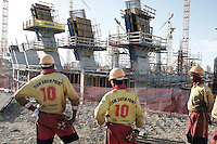 CAPE TOWN, SOUTH AFRICA - OCTOBER 24: Unidentified laborers stand at the construction site of the new Green Point stadium on October 24, 2007 in the Green Point area in Cape Town, South Africa. The stadium is one of many being built and upgraded for the 2010 World Cup. The laborers wear a uniform looking as a soccer uniform. Soccer is the most popular sport in South Africa, and because of the upcoming World Cup 2010 in South Africa the interest is increasing. For the first time the World Cup will be held on the African continent. .(Photo by Per-Anders Pettersson)...