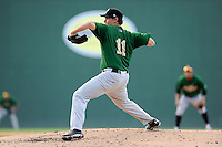 Pitcher Ricky Knapp (11) of the Savannah Sand Gnats, delivers a pitch in a game against the Greenville Drive on Sunday, July 5, 2015, at Fluor Field at the West End in Greenville, South Carolina. Savannah won, 8-6. (Tom Priddy/Four Seam Images)