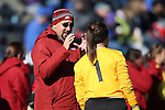 24 November 2013: Arkansas assistant coach Mario Rincon (left) talks to Cameron Carter (1). The University of Arkansas Razorbacks played the Duke University Blue Devils at Koskinen Stadium in Durham, NC in a 2013 NCAA Division I Women's Soccer Tournament Third Round match. Duke advanced by winning the penalty kick shootout 5-3 after the game ended in a 2-2 tie after overtime.