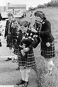 Tuning up the bagpipes, Festival & Gala Day at the Education Centre, Wester Hailes, Scotland, 1979.  John Walmsley was Photographer in Residence at the Education Centre for three weeks in 1979.  The Education Centre was, at the time, Scotland's largest purpose built community High School open all day every day for all ages from primary to adults.  The town of Wester Hailes, a few miles to the south west of Edinburgh, was built in the early 1970s mostly of blocks of flats and high rises.