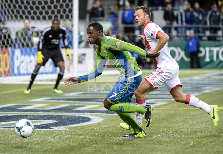 November, 2013: CenturyLink Field, Seattle, Washington: Seattle Sounders FC forward Eddie Johnson (7) pursues the ball  as the Portland Timbers take on the Seattle Sounders FC in the Major League Soccer Playoffs semifinals Round. Portland won the first match 2-1.