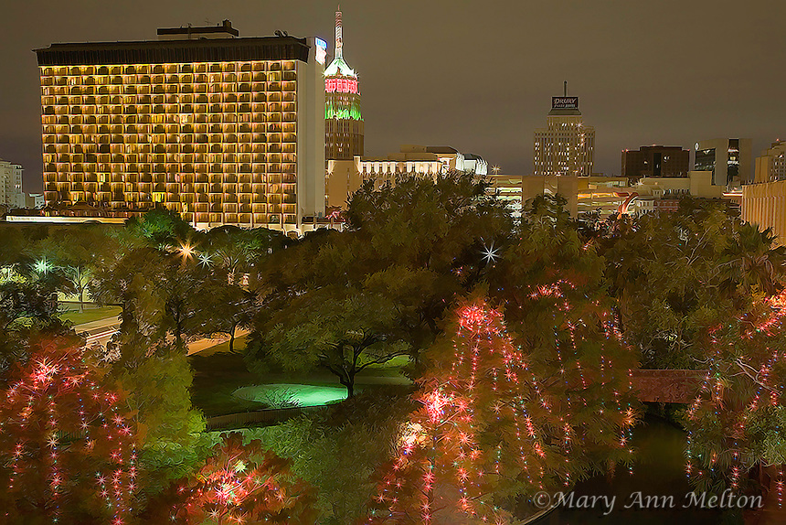 A photography based digitally enhanced cityscape of San Antonio, Texas overlooking the famous Riverwalk with the cypress trees draped in Christmas lights.