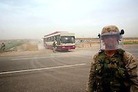 rh first bus with released prisoners leavesthe prison of Abu Graib in BAghdad on MAy 28 2004. in the same day 400 prisoners will be relased.