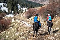 Riding horses into a backcountry yurt ski camp in the Aksuu Valley, Kyrgyzstan