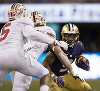 """Myles Gaskin looks for running room on a """"Wildcat"""" keeper late in the game."""