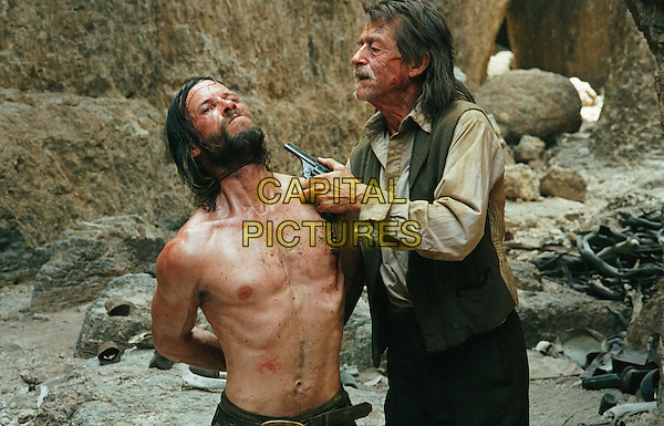 GUY PEARCE &amp; JOHN HURT<br /> in The Proposition<br /> *Editorial Use Only*<br /> www.capitalpictures.com<br /> sales@capitalpictures.com<br /> Supplied by Capital Pictures