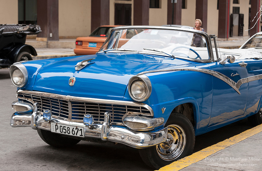 Havana, Cuba; a classic blue 1956 Ford convertible, parked on the street in Old Havana