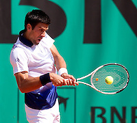 Novak Djokovic (SRB) (3) against Kei Nishikori (JPN) in the second round of the men's singles. Novak Djokovic beat Kei Nishikori 6-1 6-4 6-4..Tennis - French Open - Day 6 - Fri 29 May 2010 - Roland Garros - Paris - France..© FREY - AMN Images, 1st Floor, Barry House, 20-22 Worple Road, London. SW19 4DH - Tel: +44 (0) 208 947 0117 - contact@advantagemedianet.com - www.photoshelter.com/c/amnimages