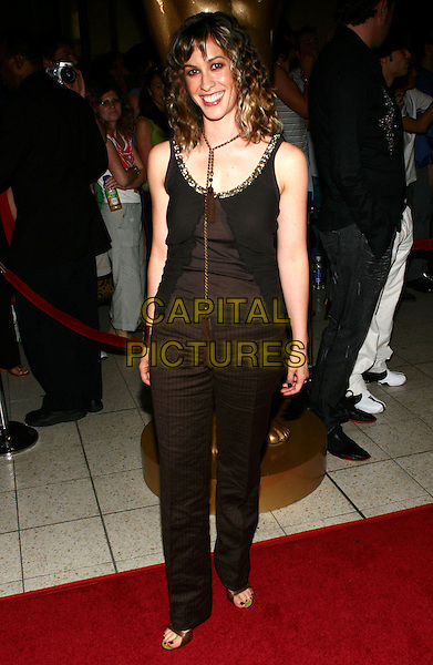 ALANIS MORISSETTE.2005 World Music Awards Arrivals held at the Kodak Theatre, Hollywood, California..August 31st, 2005 .Ref: ZL.full length black pinstripe trousers black tank top.www.capitalpictures.com.sales@capitalpictures.com.© Capital Pictures.