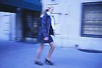 Schoolgirl walking down street