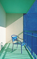 Blue chair on beach balcony