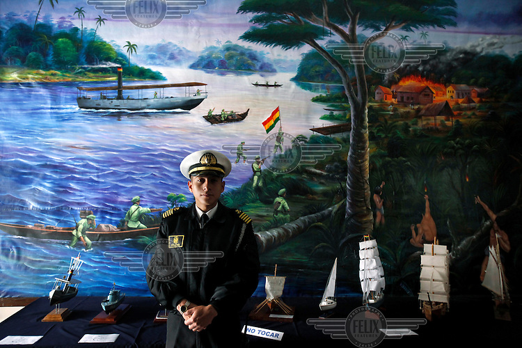 Mauricio Somoza, a naval officer, stands in front of a painting representing the War of Acre, in which Bolivia lost land to Brazil, at the Bolivian Navy school in La Paz. Bolivia lost what is now northern Chile in a war over nitrates leaving Bolivia without access to the ocean.