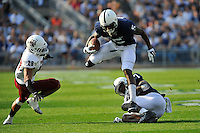 20 September 2014:  Penn State WR DaeSean Hamilton (5) hurdles fellow WR Eugene Geno Lewis (7) . The Penn State Nittany Lions vs. the University of Massachusetts Minutemen at Beaver Stadium in State College, PA.